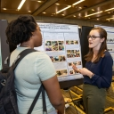 Klyce speaks with fellow GES major Neeshell Bradley-Lewis at OSR poster day