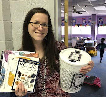 Kristina Shableski from Parkway School 1st Grade with her Bucket O' Rocks and books.