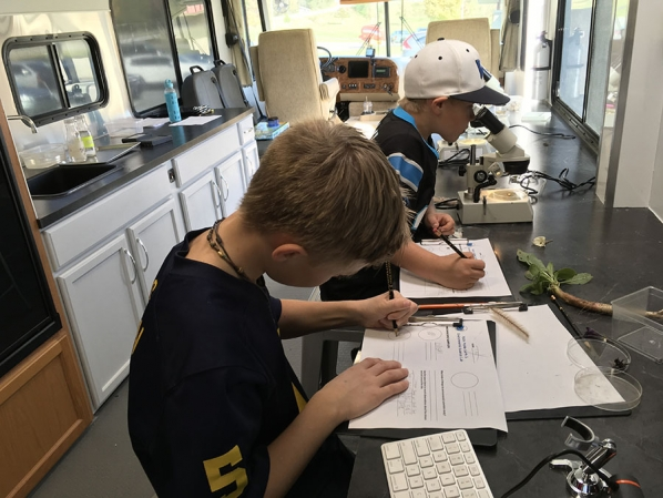Students learning in the Department's mobile laboratory