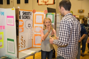 Dr. Bob Swarthout talks with Blue Ridge Elementary student about her science project.  Photo by Ellen Gwin Burnette