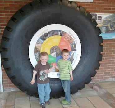 young kids with Geology department exhibit
